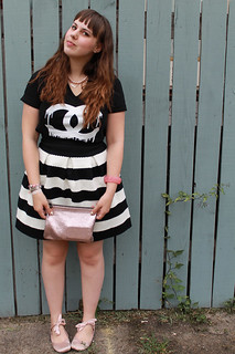 "Black and white striped bubble skirt ""Scalloped Stripes Ponte Skirt"" by Girls from Savoy for Anthropologie, Zevs dripping Chanel logo t-shirt, pink satin ballet flats with ankle ties, carved rose bangle, rose gold Marc Jacobs for Target pouch 
