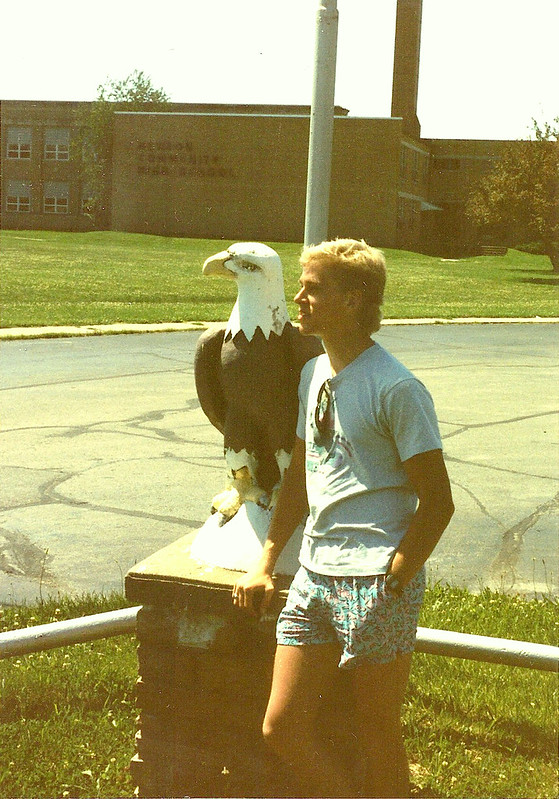 Sean poses with an eagle in front of Newton Community High School.