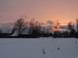 Sunset on a snowscape with a barn. | by Gerald Barnett
