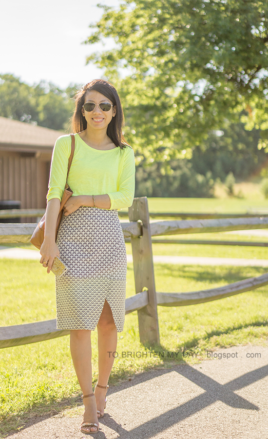 neon yellow tee, gold jewelry, jacquard wrap skirt, cognac brown tote, jeweled block sandals