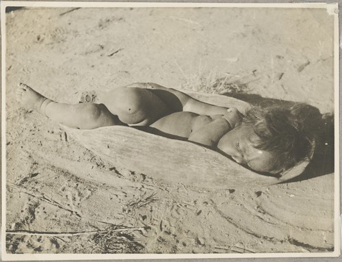 Aboriginal child asleep in a wooden dish, central Australia, ca. 1940s | by National Library of Australia Commons