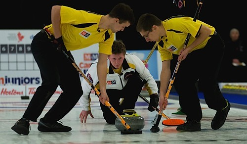 Manitoba skip, Braden Calvert throws a stone during the men's final. Sweeping for him is Brendan Calvert and Lucas Van Den Bosch | by seasonofchampions