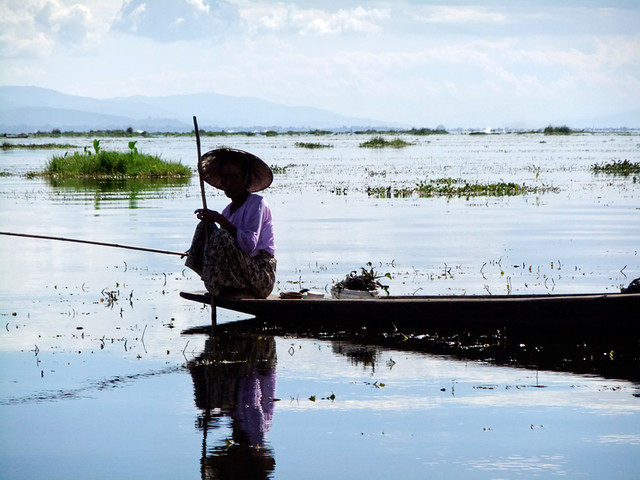 Woman on a Boat Fishing on our Inle Lake Bike Trip