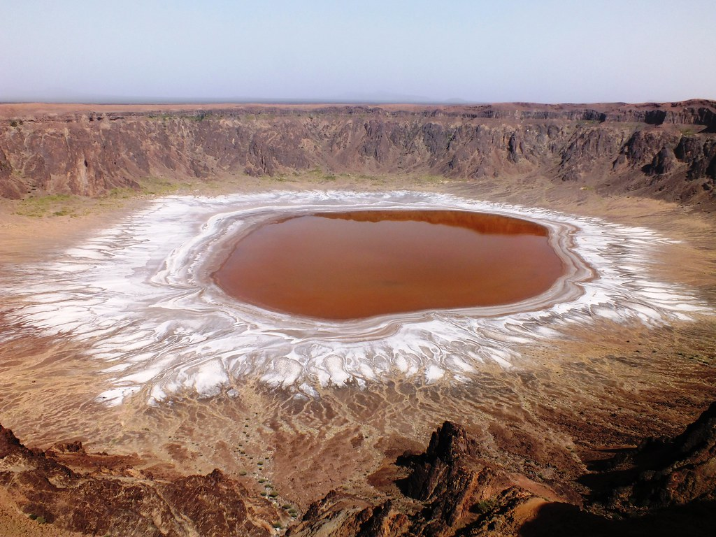 """Image result for Wahba Crater. You might think that living in Saudi Arabia is nothing but plain sand and buildings. Here are some of the natural wonders and historic places to visit.     1. Wahba Crater  Wahba Crater is near Taif is this beautiful crater once thought to have formed after a meteorite. It is 250 m (820 ft) deep and 2 km (1.2 mi) in diameter. The bottom of the crater is covered with white sodium phosphate crystals which gleams in the moonlight. Geologist found out that the crater was formed by a volcanic activity.     2. Mada'in Saleh  Mada'in Saleh is located near Al Ula, it is a settlement area that dates back to the time of Noah but before Moses.  It has been occupied by Thamud people who carved their homes in the mountains. The Muslims believed that the city was destroyed and the people were punished by Allah after they started idol worship, the place has also earned the reputation of a """"cursed place"""".   Madain Saleh (6730128379).jpg   3. Afsar Lake  Afsar Lake in Al Hasa Region- The biggest lake in Arabian Peninsula, and it is the lake that hosts around 2 million migratory birds each year from Africa to Europe and Asia.   Image result for Afsar Lake in Al Hasa Region    4. Desert Roses  Desert roses in Eastern Province- In the eastern province, you will most likely find these rocks formed in the shape of roses or flowers buried in the sand.     Photo Credit: trekearth.com   5. Farasan Islands  Farasan Islands- It is a coral islands group situated near Jizan. It has wonderful coral reefs formation that stretches for miles. The easiest way to get there is by free ferry from Jizan port.        6. Jabal Qara  Jabal Qara cave in Hofuf-  there are so many stories about the cave, some calls it Ali Baba's cave from the popular folktale Alibaba and 40 thieves. Some also call it Judas cave.         7. Wadi Al Jinn  Wadi Al Jinn- Are you loving more folklores? From the Alibaba's cave another city where traditional believe there is jinn power in the valley. A"""