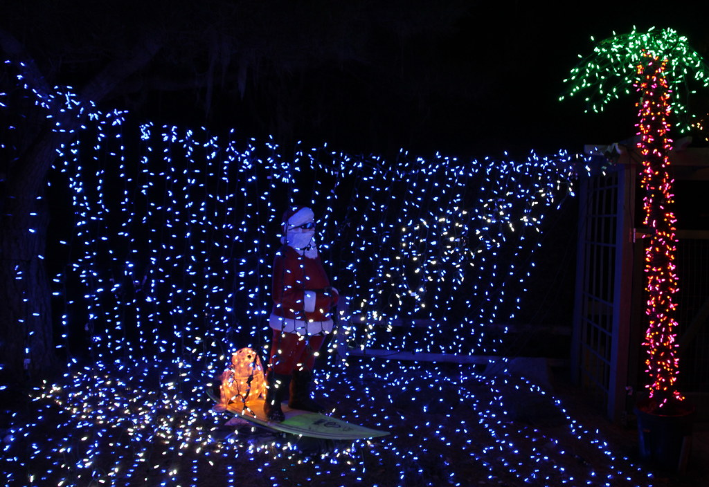surfin santa in a wave of lights at the cambria christmas market light show