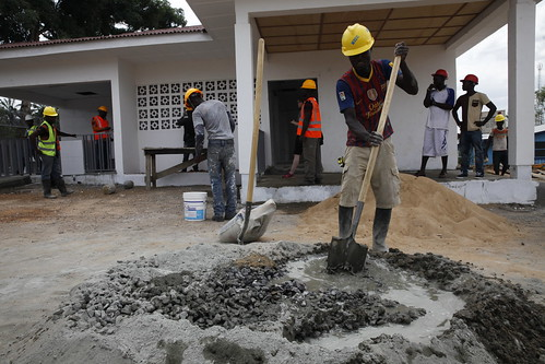 Construction workers build a new triage and water tank system | by World Bank Photo Collection