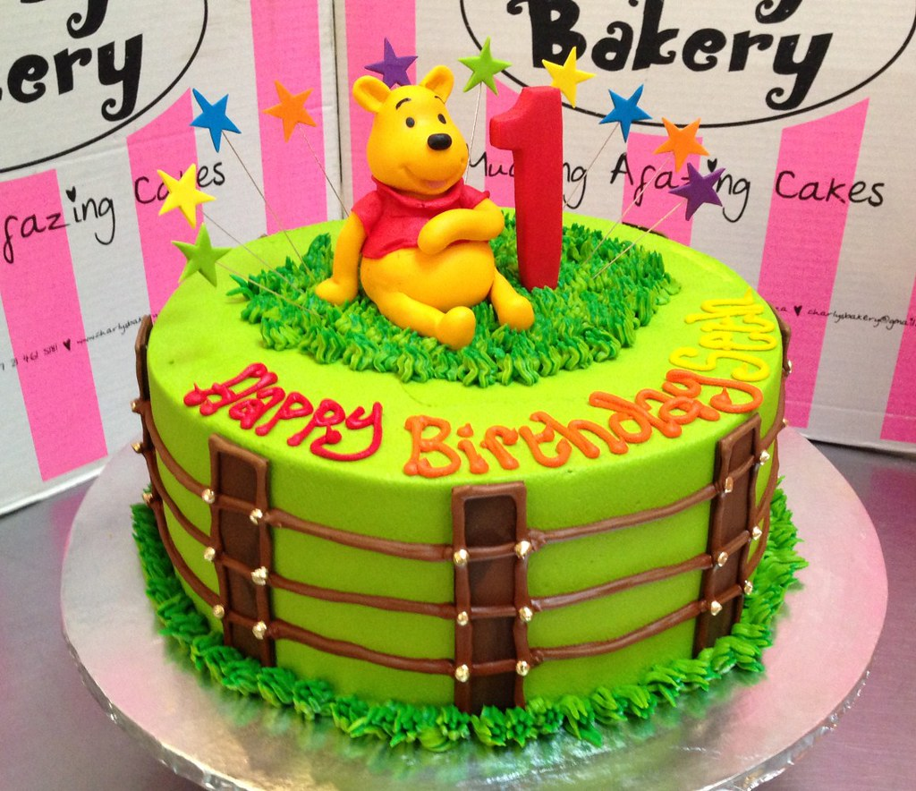 Winnie The Pooh Themed 1st Birthday Cake With Fondant Piped Fence On Sides