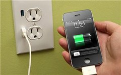 Apple iPhone charging at wall USB port | by IntelFreePress