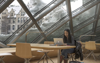 A student studies in the Mansueto Library | by University of Chicago Library