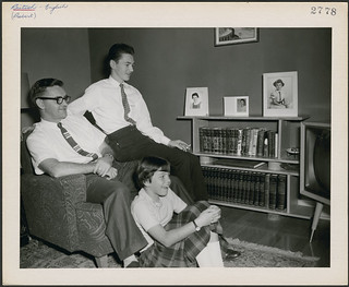 Albert Probert watching television at home with his son and daughter in Guelph, Ontario / Albert Probert regarde la télévision avec son fils et sa fille dans sa maison située à Guelph (Ontario) | by BiblioArchives / LibraryArchives