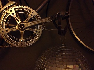 Random photo of bike on wall with disco ball attached | by lock7cyclecafe