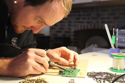 Tyler soldering some headers | by Rock On Audio