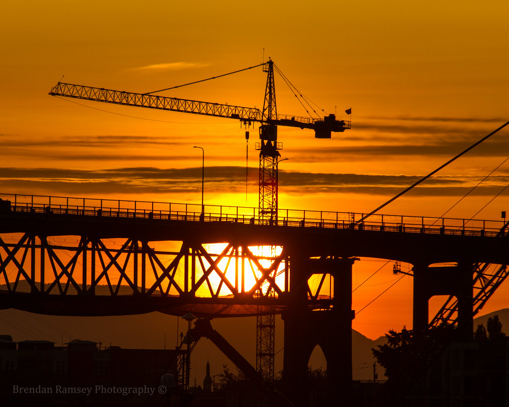 After being up in the sky all day, the sun gets very tired. A Morrow crane helps lower her softly as the day ends.