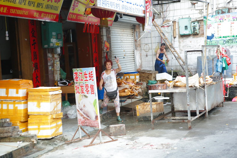 A dog meat seller at Yulin