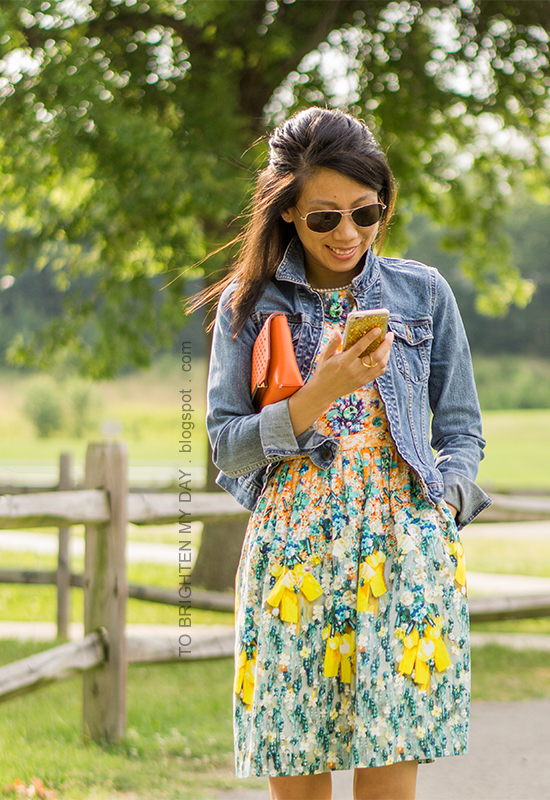 denim jacket, orange clutch, floral dress