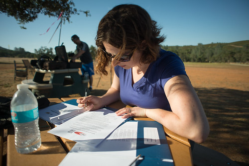 Tara Signing Powered Paragliding Waivers | by goingslowly