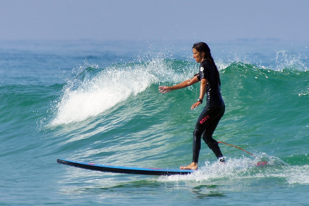 the roxy surfer girl back on the longboard by david b just passed