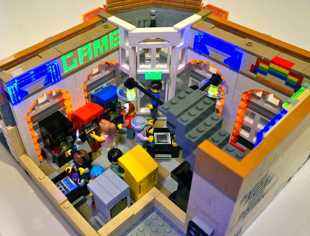 Flynn\'s Arcade Interior Blacklit | The arcade games have coi… | Flickr