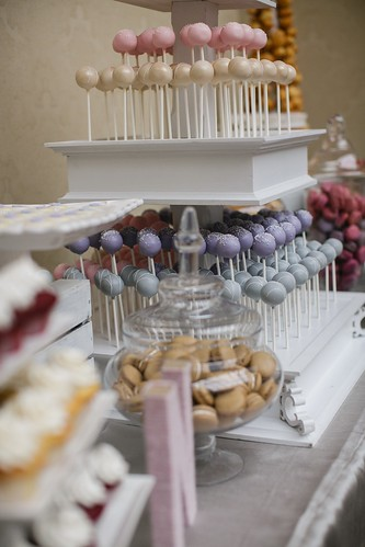 Pastel cake pops on our custom white three tier stand | by Sweet Lauren Cakes