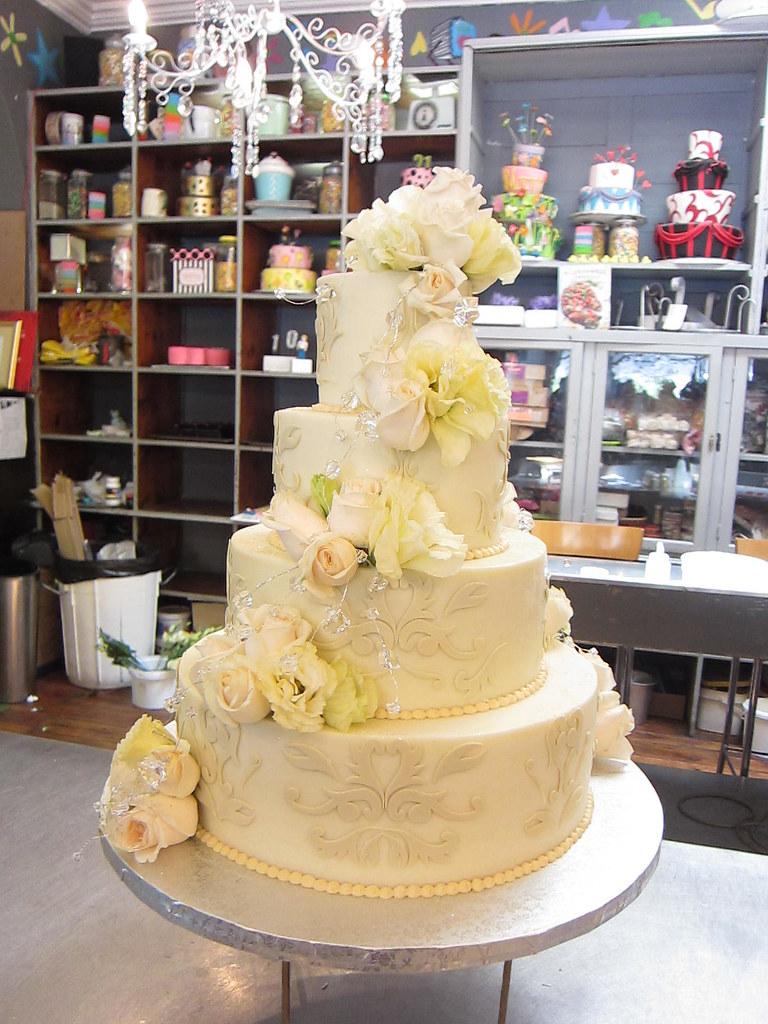 4-tier wedding cake iced in smooth white chocolate ganache… | Flickr