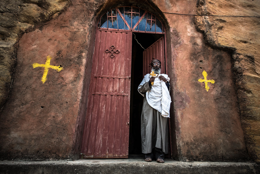 Orthodox priest at Wukro Chirkos is a monolithic church, tigray