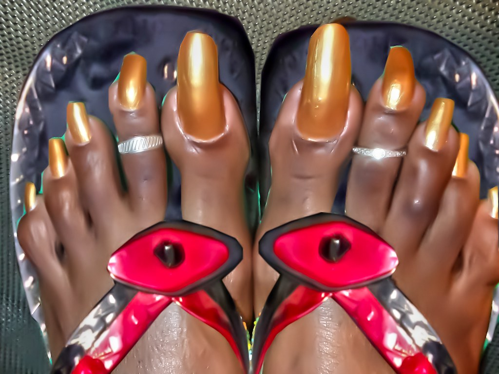 very long toenails in african sandals | a collection of very… | Flickr
