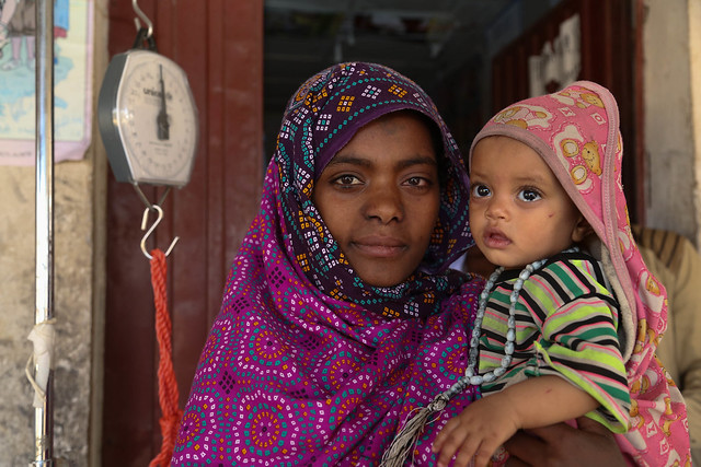 Fatima Yesuf, 25, brings her 8 months old daughter to the Metiya health center for checkup and to receive the Plumpynuts food supplements