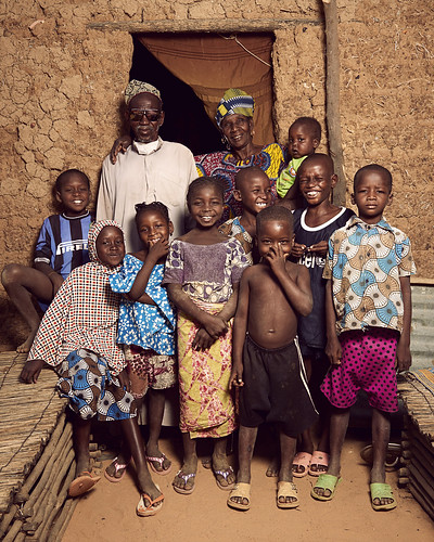 Soumana, his sister Hadjo, and children from Kosseye Satom pose for a picture | by World Bank Photo Collection