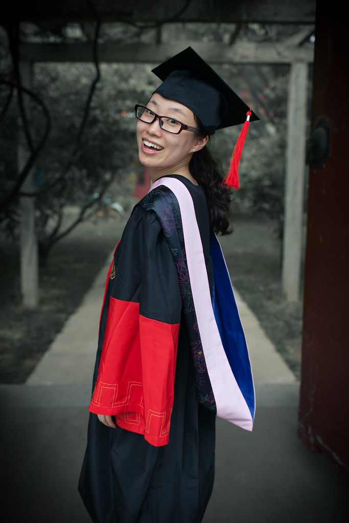 a female doctor wearing the graduation cap and gown in Pek… | Flickr