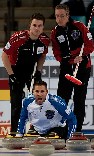 Kamloops B.C.Mar5_2014.Tim Hortons Brier.B.C. skip John Morris,Ontario skip Greg Baldson,third Mark Bice.CCA/michael burns photo | by seasonofchampions