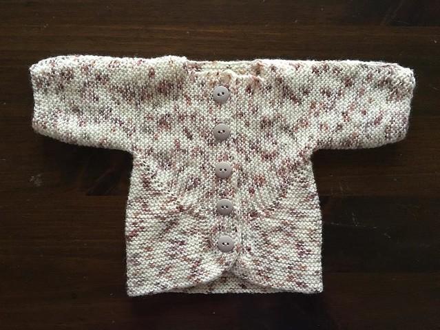 Surprise! Knit blob folded up, sewed up, buttoned up. #babysurprisejacket #knitting