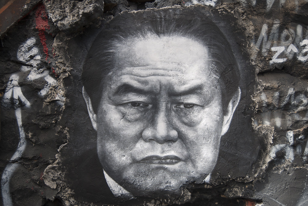 Zhou Yongkang, painted portrait./Source: Flickr/thierry ehrmann
