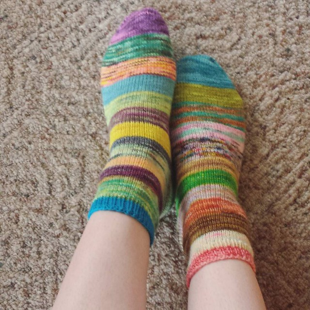 my scrappy socks from last year. I am contemplating frogging them 😕 I knit them when I only knit toe up, so I don't love the cuff and I don't love the fit around my heel anymore. no ends were ever sewn in, so it wouldn't be crazy to frog... I lov