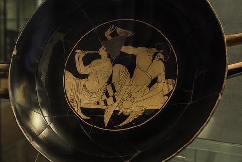 Trash - I | Symposium: hetaira plays pipes while a man