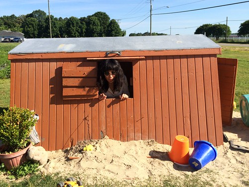 Ana Peeking Out of Kiddie Clubhouse at Cullipher Farm Market (May 25 2015)