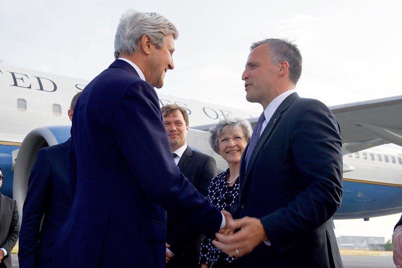 Secretary Kerry Speaks With Ambassador Gifford Upon His Arrival to Denmark