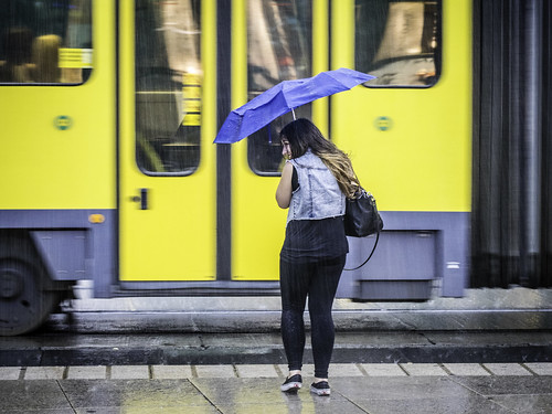 Woman with Umbrella in front of Tram | by kohlmann.sascha
