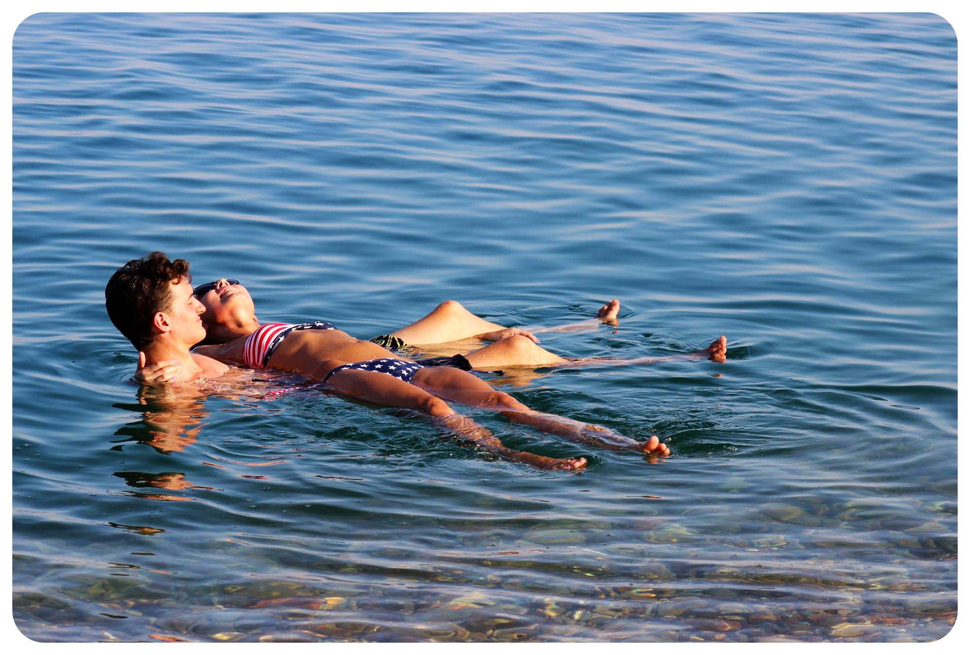 dead sea floating couple