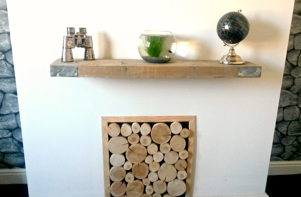 Decorative Whole Logs From The Log Basket Stacked In An Alcove With Rustic  Shelf Feature.