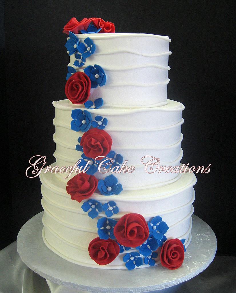 Elegant White Butter Cream Wedding Cake With Whimsical Red Flickr