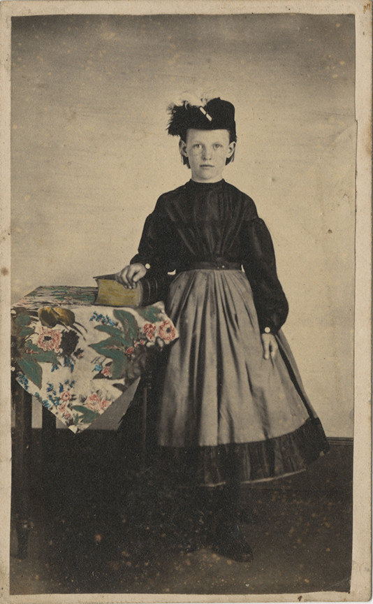 Carte De Visite Of A Girl With Tinted Table Cloth