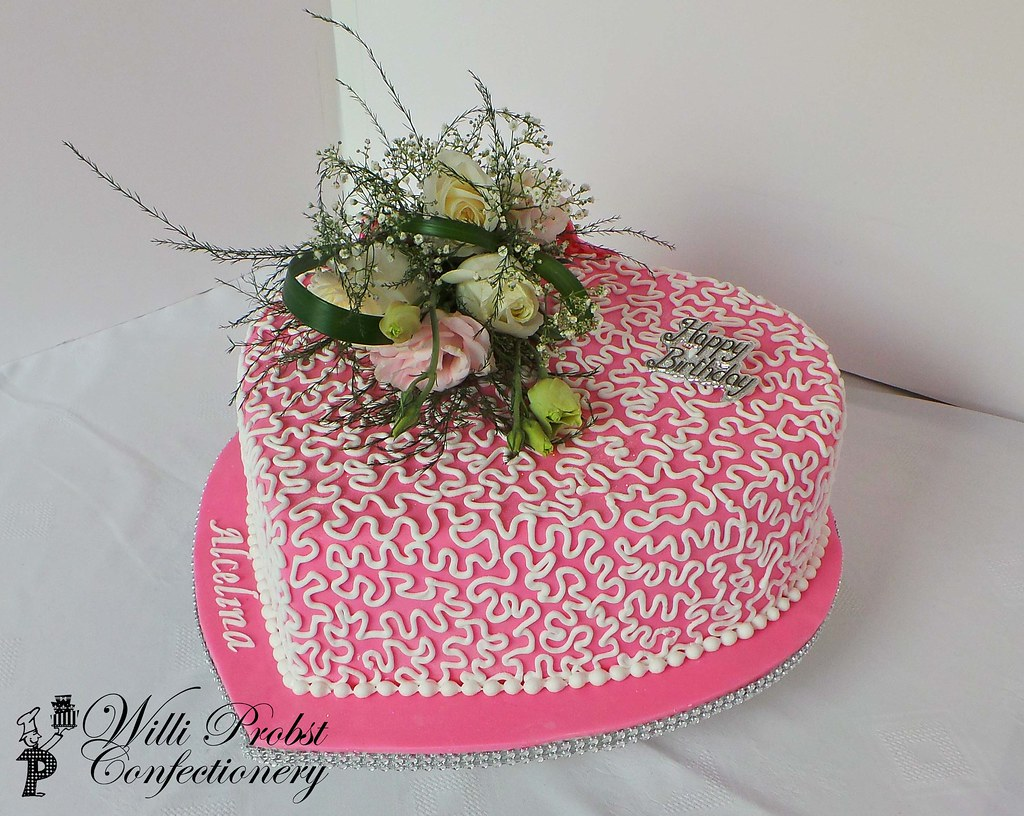 Pink heart shaped birthday cake with fresh flowers flickr pink heart shaped birthday cake with fresh flowers by willi probst bakery izmirmasajfo