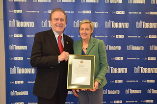 Presenting a scroll to City Clerk, Ulli Watkiss | by Councillor Norm Kelly
