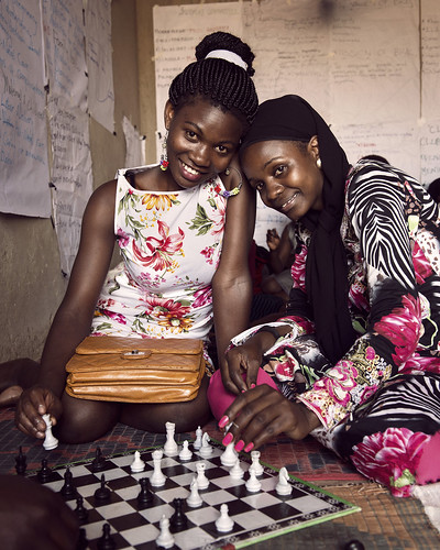 Florence and Diana play chess ikaaya girls' club in northern Kampala | by World Bank Photo Collection