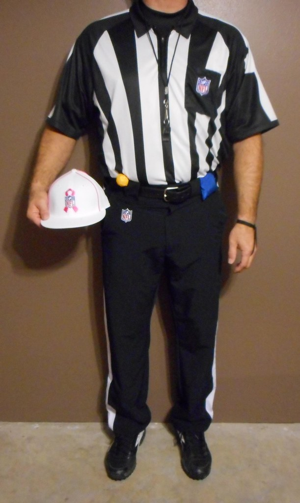 by Authentic NFL officials short sleeve uniform with pink and white Referee  NFL hat.  a57c3c593d9