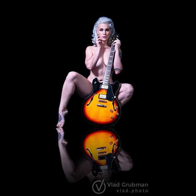 Nude girl with guitar