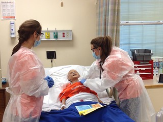 In a simulation exercise, senior nursing students at Auburn University treated a young patient with cystic fibrosis who had acquired pneumonia, an infectious disease. | by Auburn University