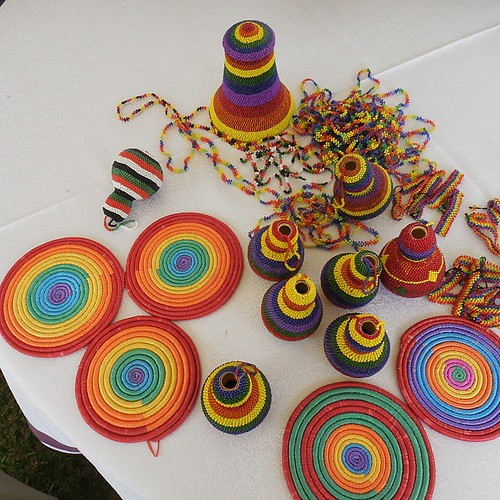 The Rainbow Health Alliance Mbarara members make and sell these traditional Acholi items covered in rainbow colors. I loaded up. | by LIPTV