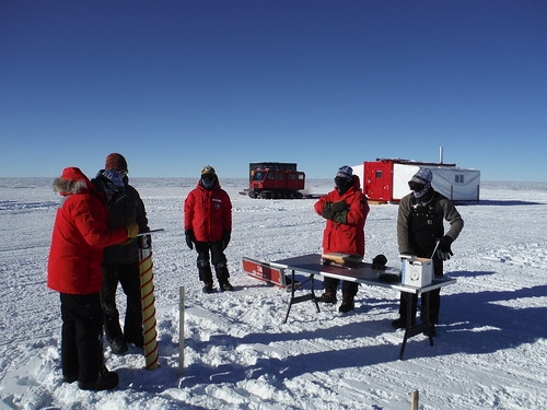 Drilling one of six shallow cores at the drill site for snow density measurements | by U.S. Ice Drilling