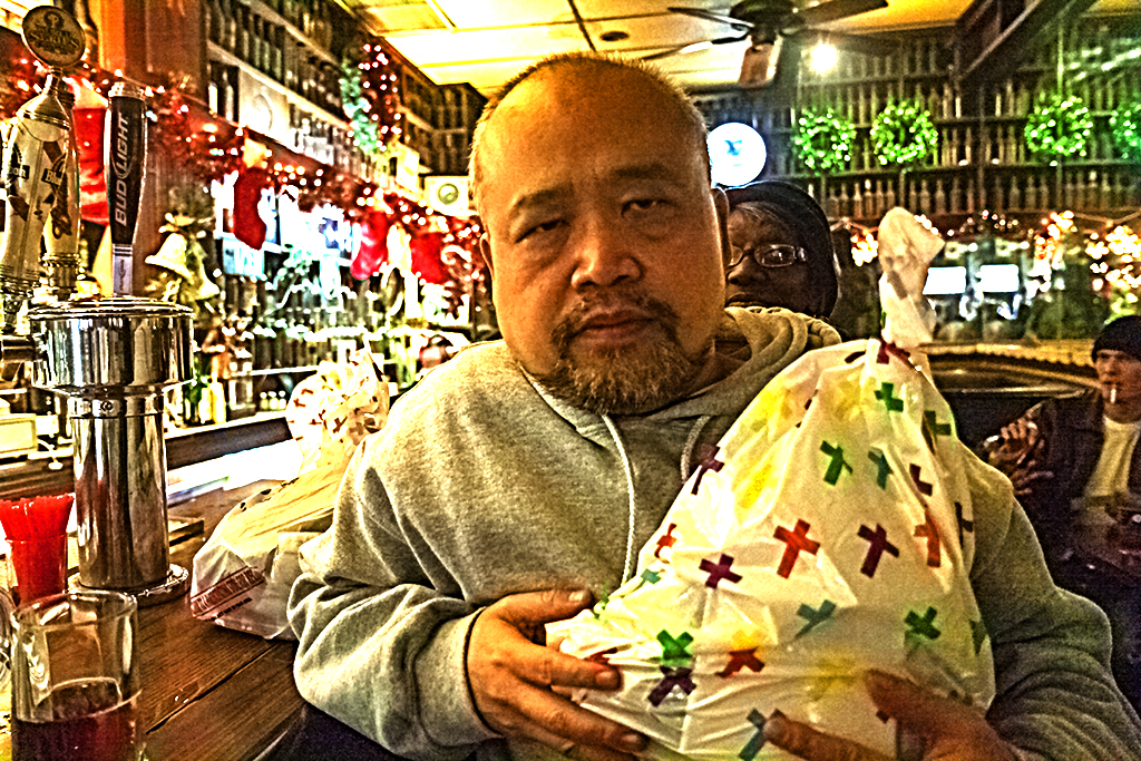 Linh-Dinh-in-Jack's-with-bag-of-gifts-on-Christmas-Eve--Kensington
